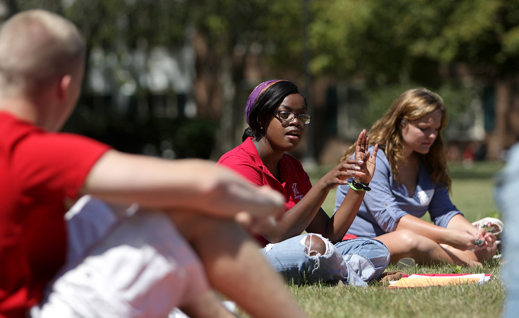 Small groups gather outside dorms and living-learning communities and share like interests.