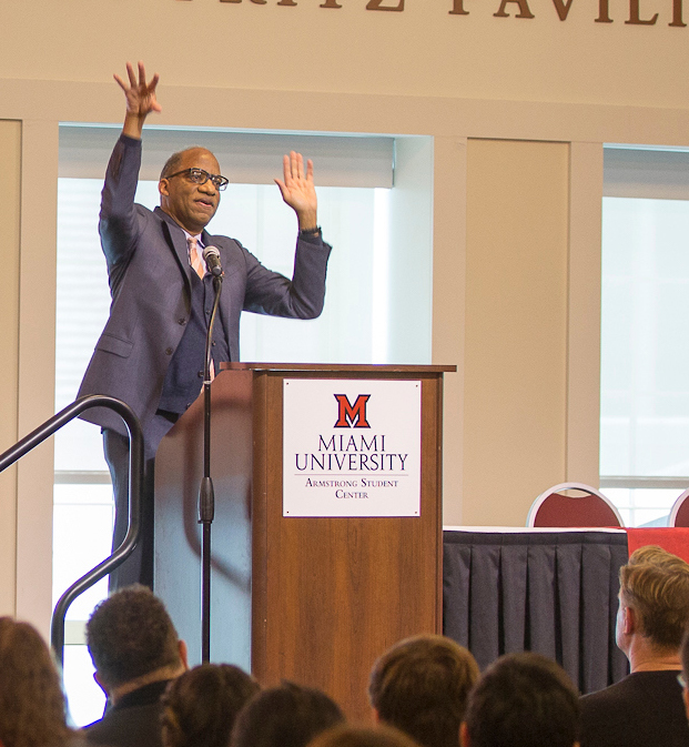 Wil Haygood animatedly speaking to an audience of Miami students