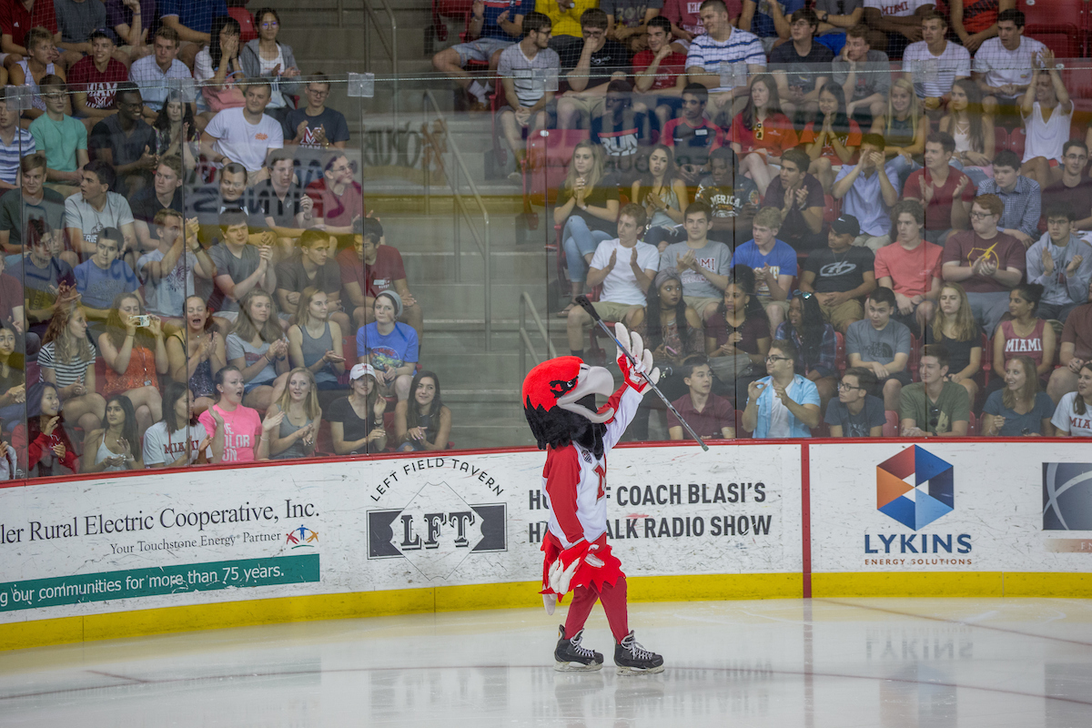 Swoop skates across the ice rink to a crowd of first-year students