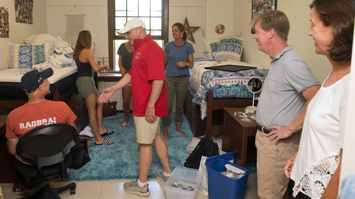 President Gregory Crawford greets new families and students in the residence halls