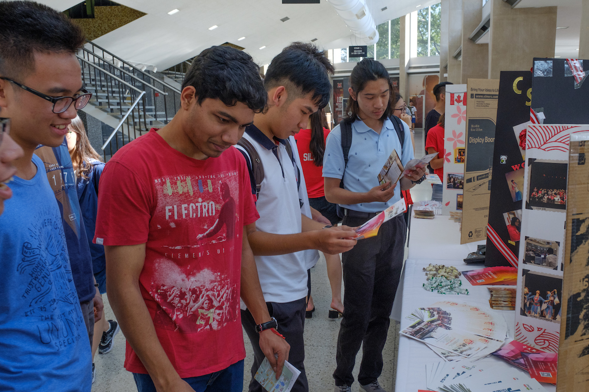 International students visit the various stations at the resource fair