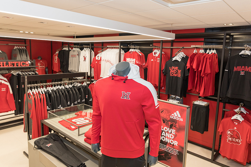 The men's section, adorned with red walls and new merchandise, of the new Adidas concept shop in Shriver