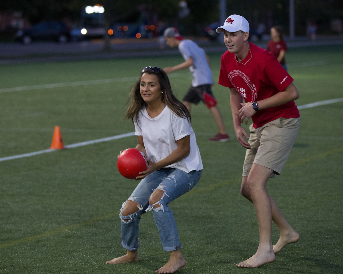 Students play co-ed dodgeball at Cook Field