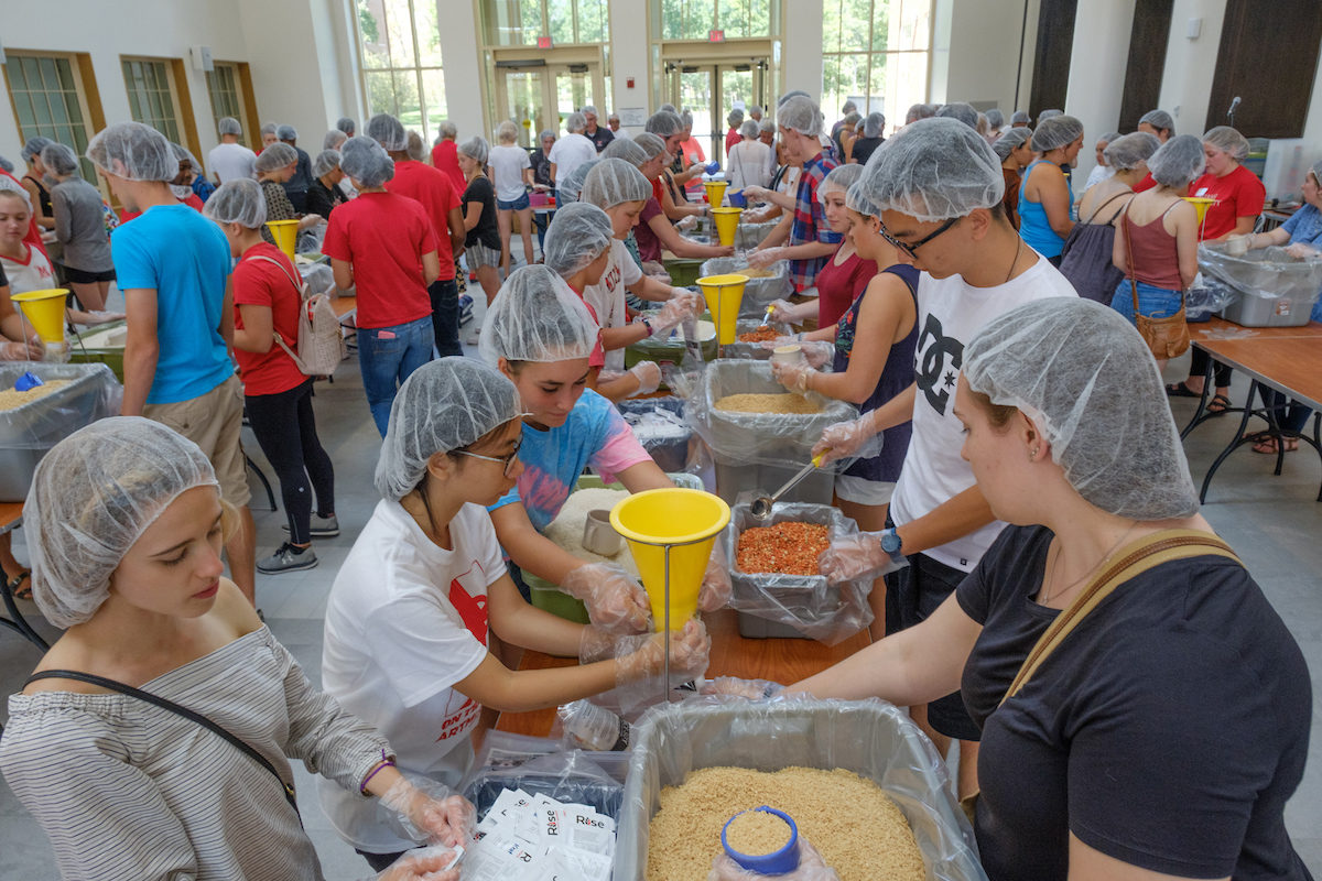 Rise Against Hunger: many student volunteers help to pack thousands of meals for the hungy