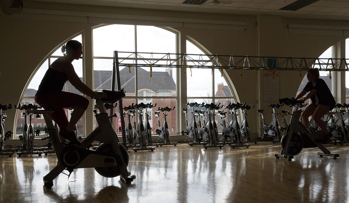 an instructor leading a spinning class