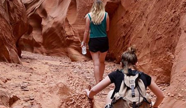 two students hiking in a canyon