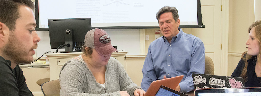 FSB professor Wayne Speers working with students in his classroom