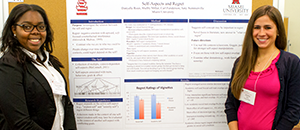 Two students present a research poster