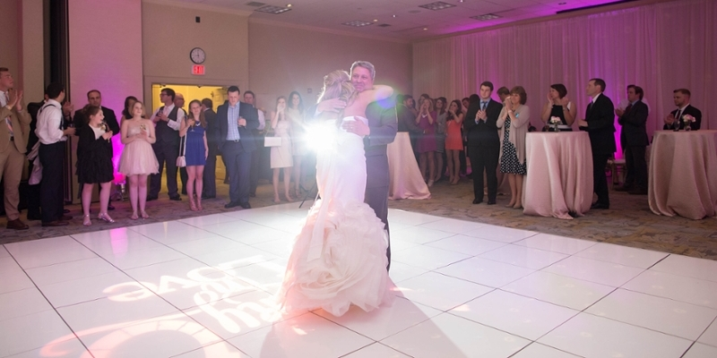 A bride and her father dancing.