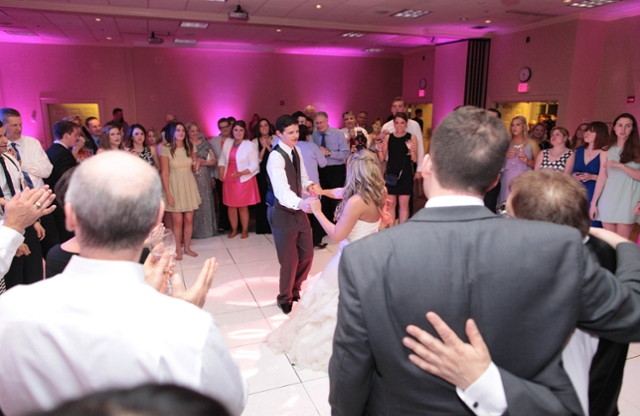 A bride and groom dancing.