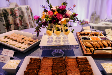 An assortment of pastries and drinks for a wedding.