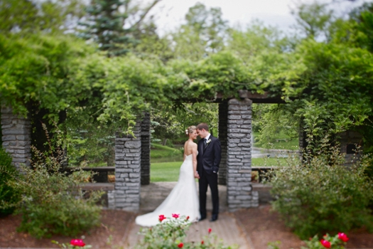 A bride and groom in the Conrad Formal Gardens.