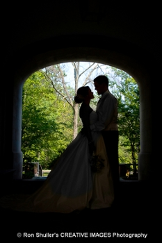 A bride and groom under the Upham Arch.