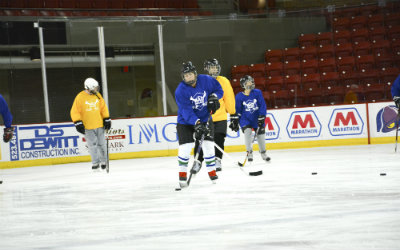adults playing hockey