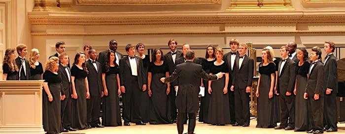 Chamber singers performing on stage during an event.