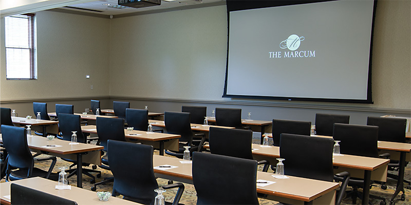 another view of a classroom style setup utilized for a presentation-style conference