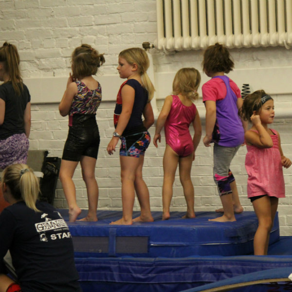 Youth gymnastics students