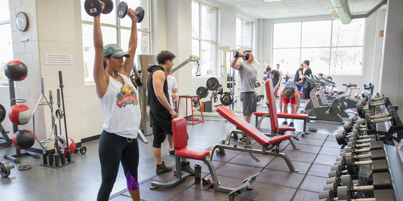 Students using the free weights at the Rec Center.