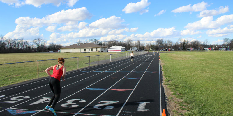 People running on the track outside of Chestnut Field House