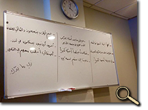 enlarged photo of Arabic on blackboard