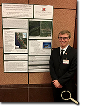 enlarged photo of Max Leveridge and research poster