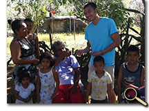 enlarged photo of Mark Loh with Nicaraguan family