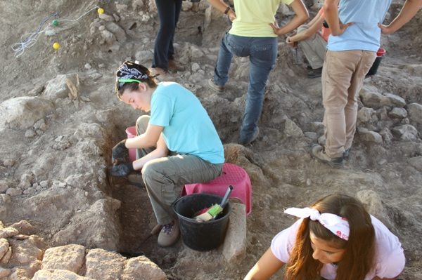 Caroline Sausser excavates material from the site