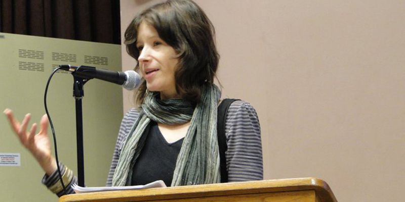 Creative Writing Professor Cathy Wagner reading at Writers Harvest event.