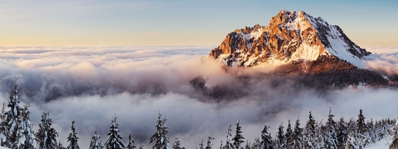 A mountain peers through the clouds in Slovakia.