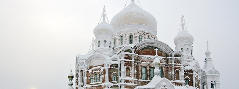 A Russian church covered in snow.