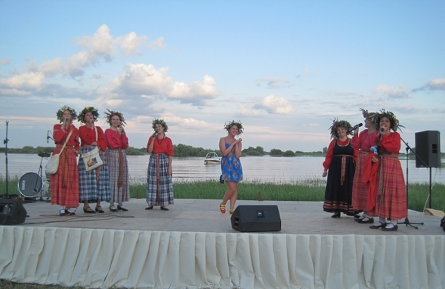 Students dancing on stage in festival