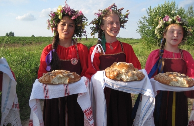 Girls serving bread at festival