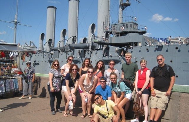 Students in front of naval ship