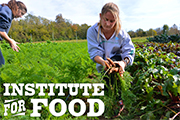photo of students harvesting carrots at the Institute for Food's Farm