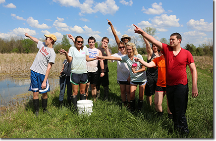 photo of students doing wetland restoration work