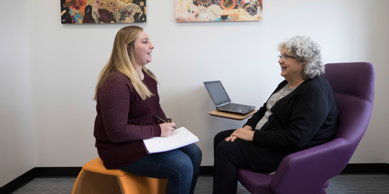 Scripps staff member and her graduate assistant discuss a research project.