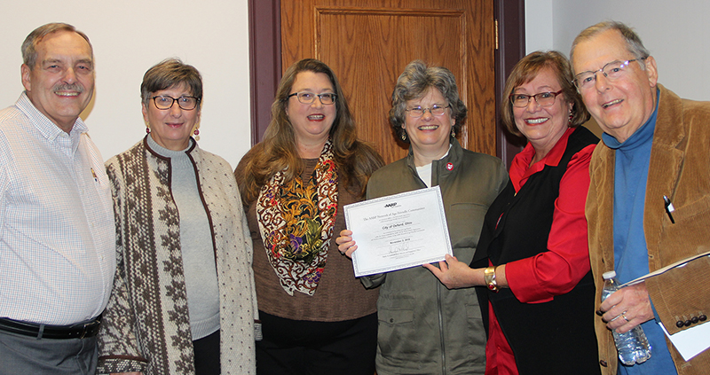 Celebrating the acceptance of the Oxford community into the AARP Network of Age-Friendly Communities are members of City Council and the Oxford VillAGE Network Steering Committee (from left) Steve Schnabl, Catherine Hollins, Jessie Leek, Mayor Kate Rousmaniere, Ann Whelpton and Steve Dana.