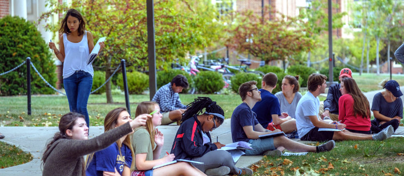 students drawing outdoors during class photo by Scott Kissell