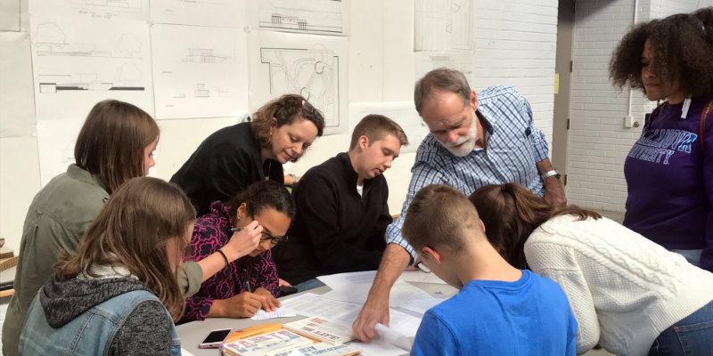 J Elliott and Mary Ben Bonham working with students in Atrium