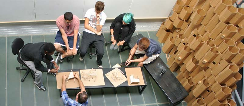 Students and faculty discuss sketches and models