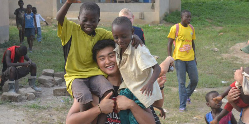 student with children in Ghana