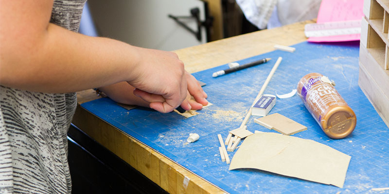 hands working on model