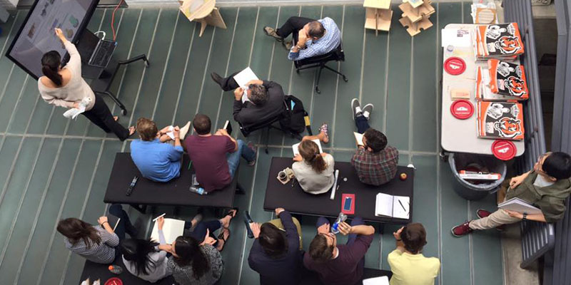 Faculty and students in the atrium, as seen from overhead