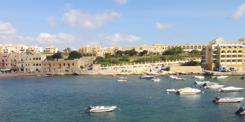 Seaport in Malta, with buildings and small watercraft