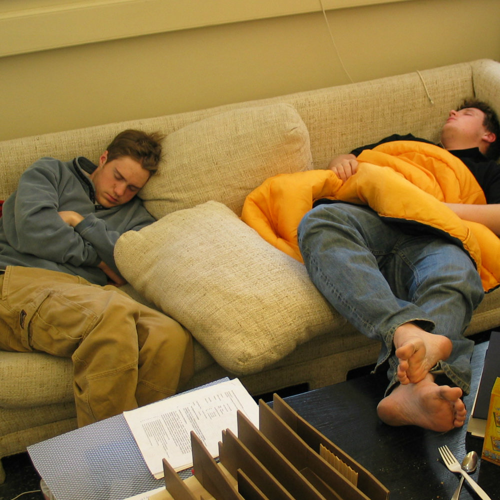 students sleeping on couches in studio
