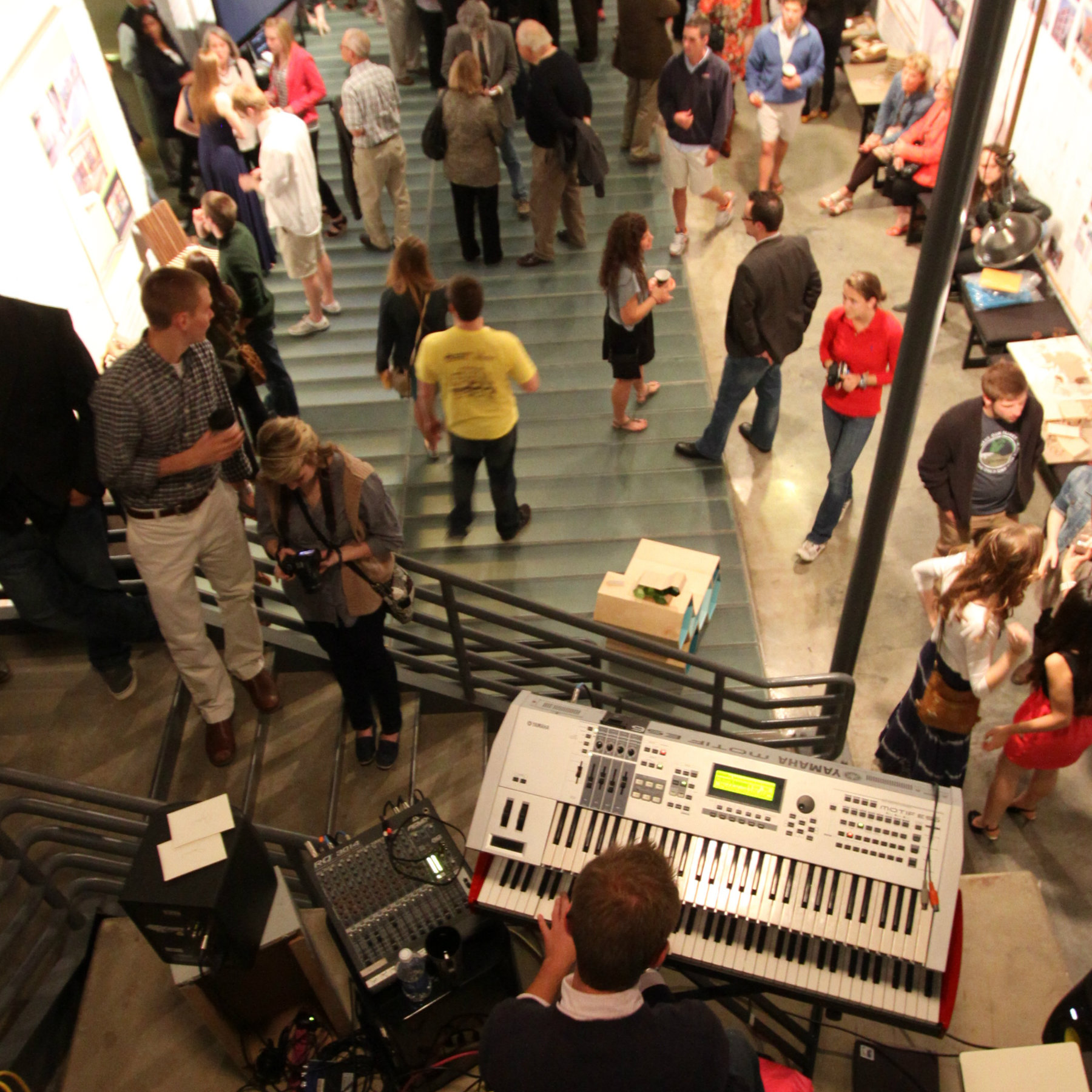 atrium full of people at open house with keyboard in the foreground