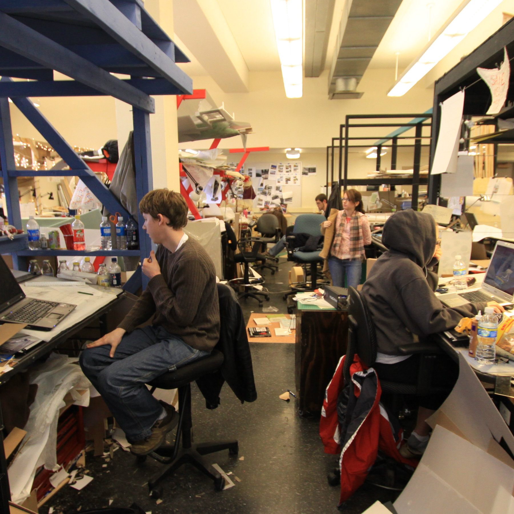 students working at their desks in studio