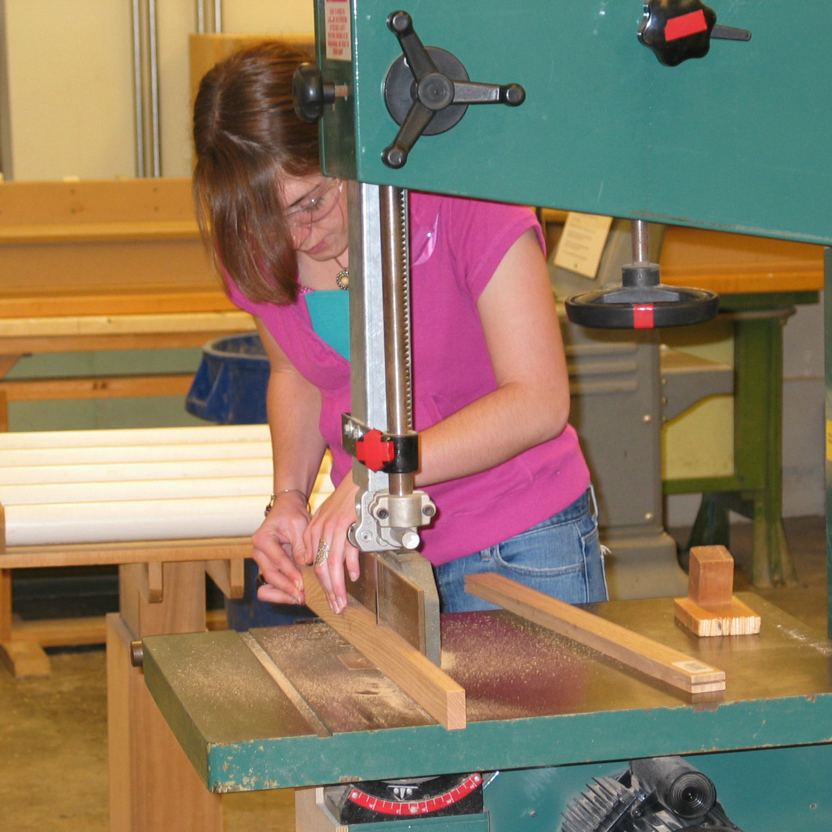 student using saw in woodshop