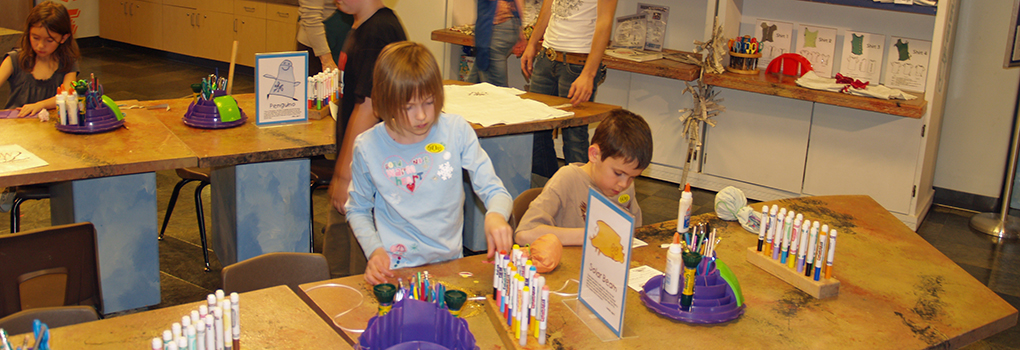 An adult and child interact in Buell Children's Museum Art Room