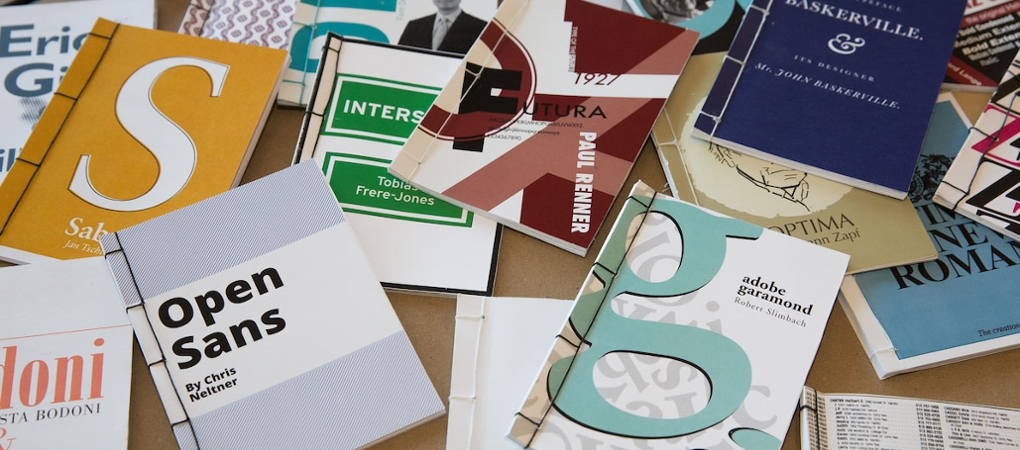 An assortment of brochures and booklets, highlighting typefaces and design